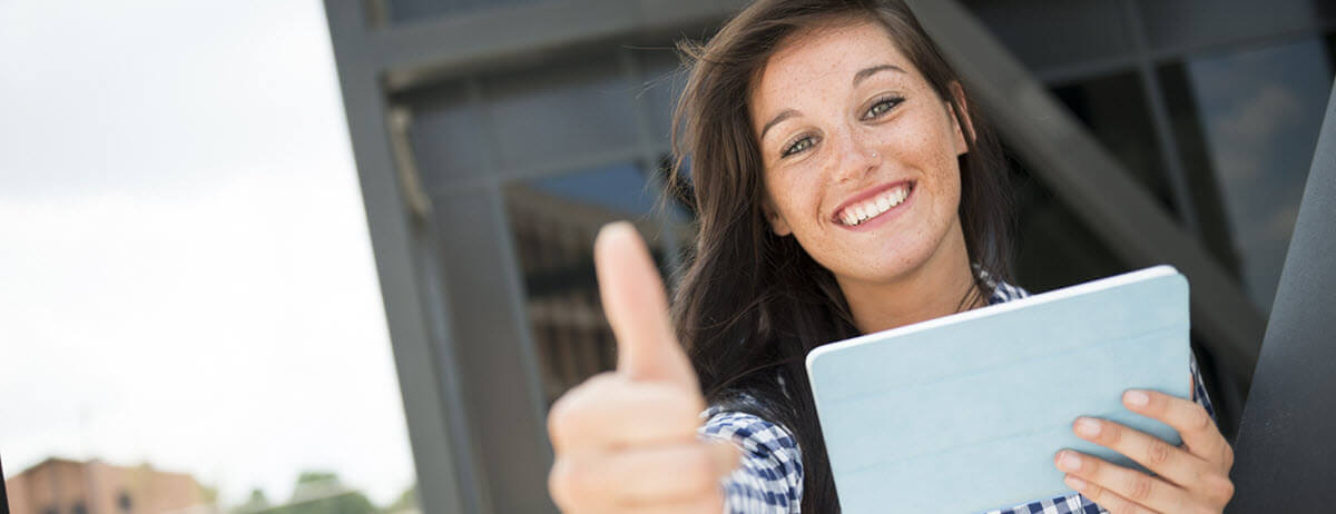 girl-with-tablet-thumbs-up-1.jpg